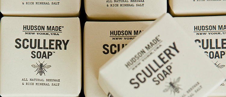 "Scullery Soaps by Hovard Design. ""These artisanal soaps are hand-numerated to identify the batch number and wrapped and sealed with a sticker. Simple one-color letterpress printing exemplify 19th century graphics and product packaging which is an ongoing inspiration for the brand."""