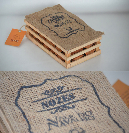 This packaging for gourmet nuts by <a href='https://www.behance.net/gallery/14224943/Package-Design-Gourmet-Nuts'>Márica Lopes</a> (Portugal) uses natural materials of linen and wood to transmit the message that these are hand-picked organic nuts of higher quality than the mass-produced ones.